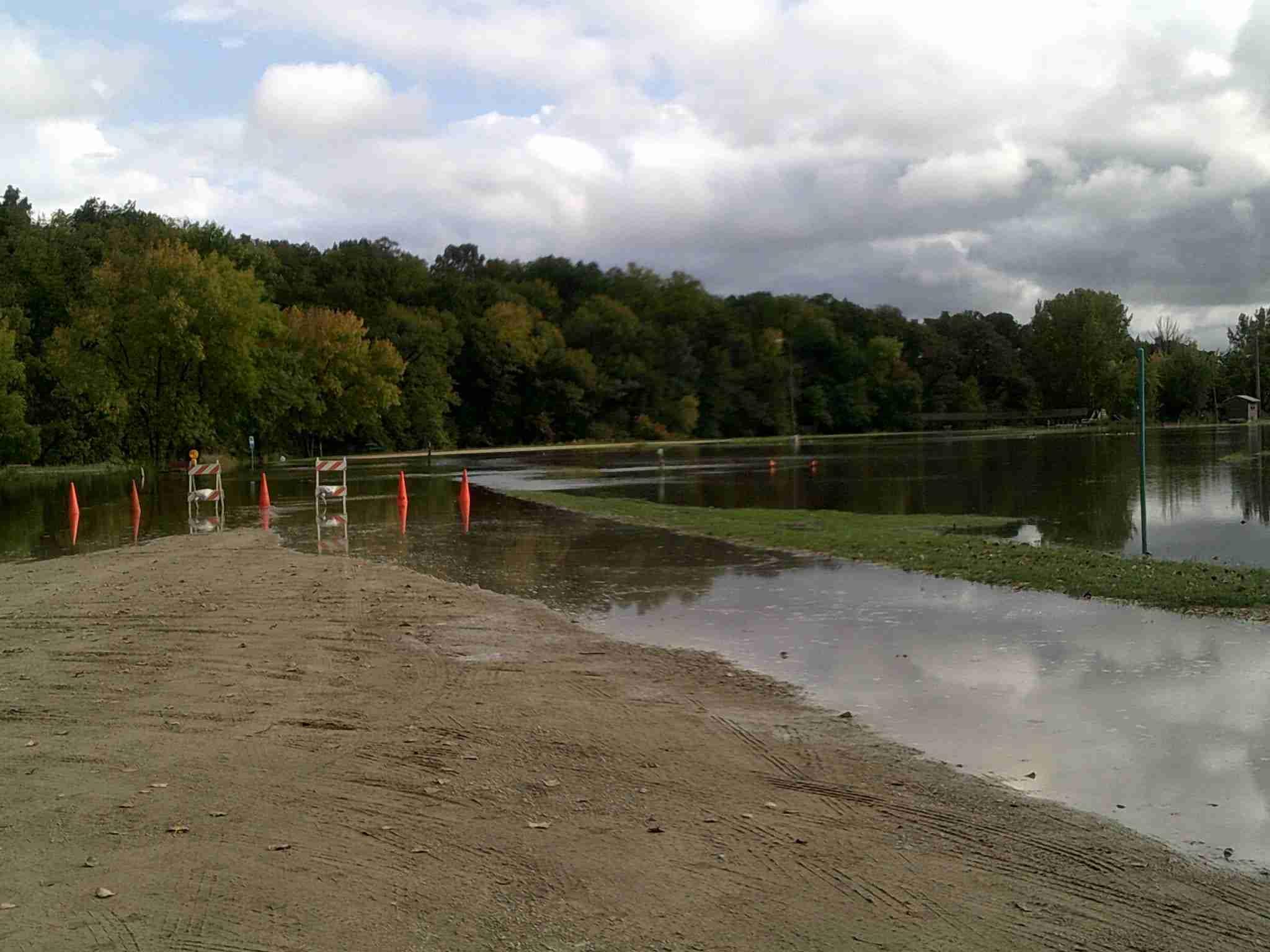 The Winnebago River floods the area bike trail.